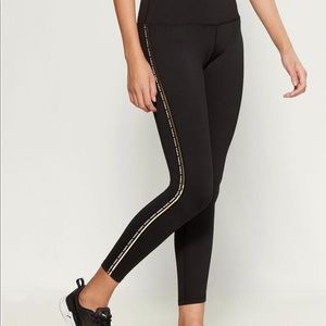 Bebe legging w/ logo down the side and gold stripe